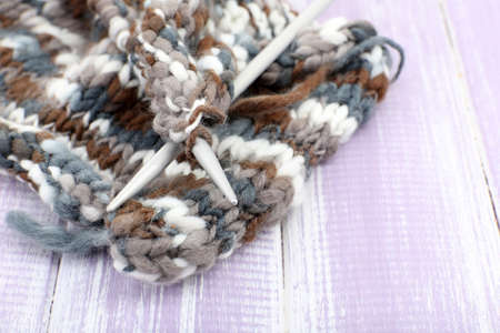 spokes: Knitting with spokes on wooden background