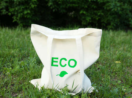 Eco bag on green grass, outdoors photo