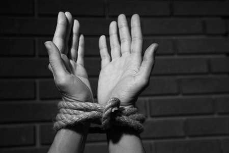 Tied hands on dark background photo