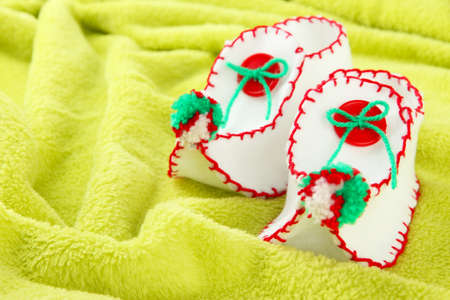 Decorative Christmas shoes on fabric background photo