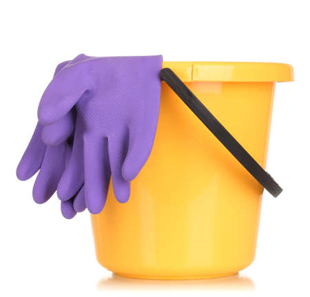Bucket and gloves for cleaning isolated on white photo