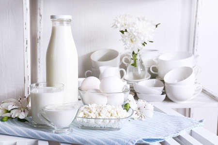 Still life with tasty dairy products on table photo