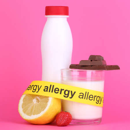 Allergenic food on pink background Stock Photo