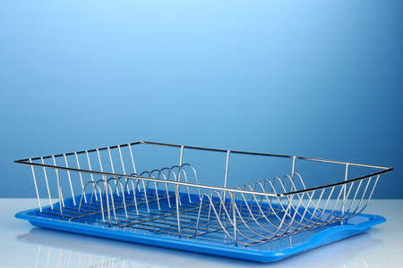 the draining: draining board on blue background Stock Photo
