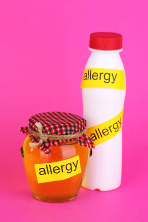 Allergenic food  on pink background photo