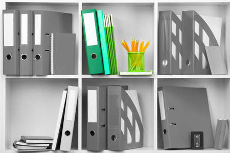 shelve: Concept of individuality.One color shelve with stationery among grey shelves with stationery