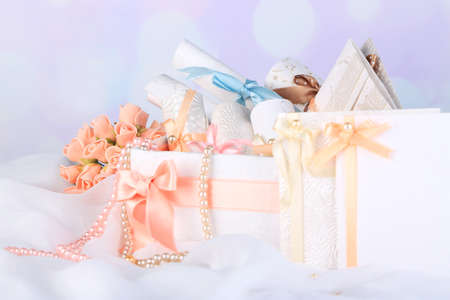 Beautiful handmade wedding cards in box, on light background photo