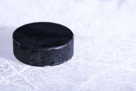 hockey ice: Black hockey puck on ice rink background