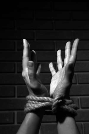 defenseless: Tied hands in shades of grey