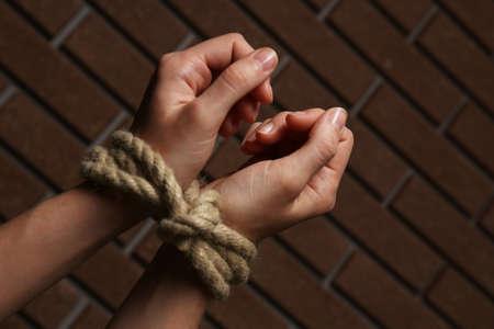 Tied hands on dark background