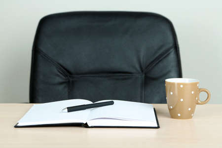 Empty workplace in office on gray background Stock Photo