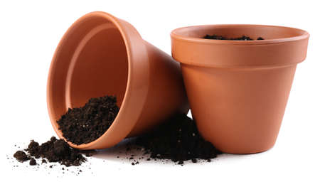 Clay flower pots with soil, isolated on white  Stock Photo
