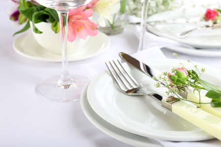 Table setting with spring flowers close up photo