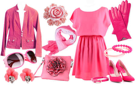 Collage of clothes in pink colors isolated on white photo
