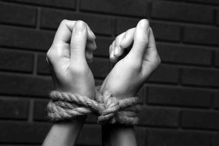 Tied hands in shades of grey photo