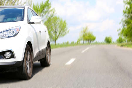 suv: Very fast driving car on road