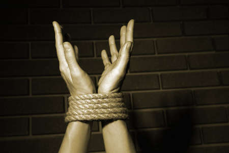 captivity: Tied hands in shades of grey