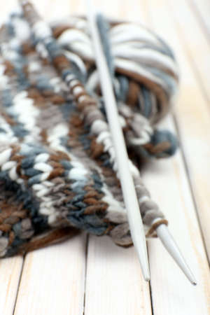 Knitting with spokes on wooden  photo