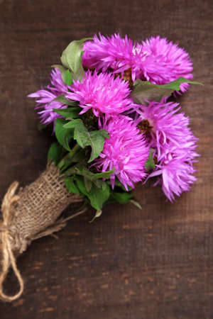 Cornflowers on wooden  photo