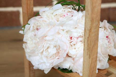 Beautiful wedding bouquet on   wooden stand on bricks  photo