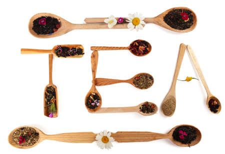 Assortment of dry tea in wooden spoons,  isolated on white photo