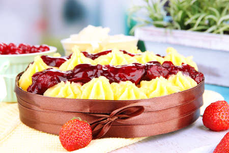 Tasty fruity homemade pie with berries, on table photo