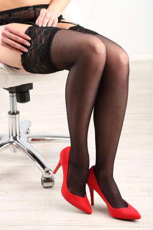 garter: Stockings on perfect woman legs, close up