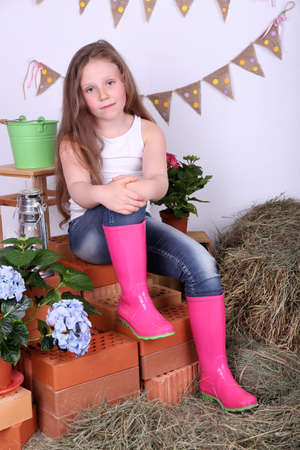 Beautiful small girls on country style background photo