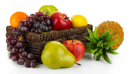Ripe fruits in basket isolated on white photo