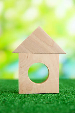 Wood house on grass on natural background photo