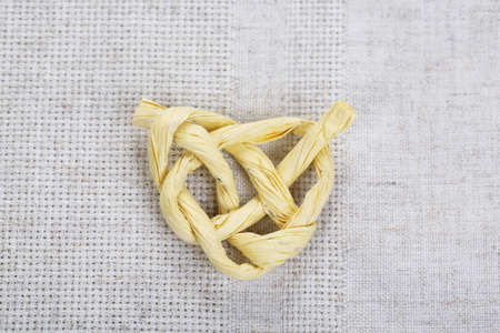 Heart shape from rope, on color fabric background photo