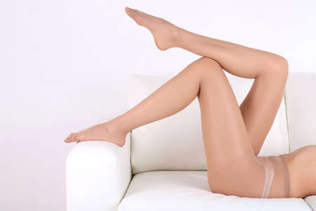 Stockings on perfect woman legs, close up photo