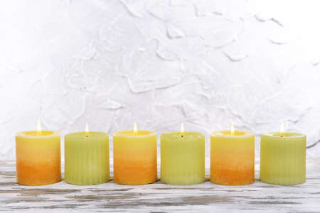 Beautiful candles on table on grey background photo