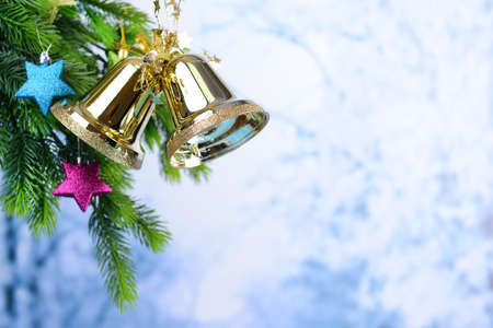 Bells with Christmas decoration on light background photo