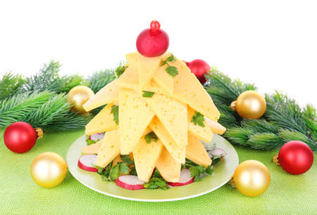 Christmas tree from cheese on table on white background photo