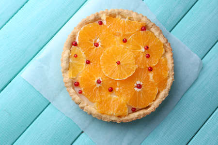 orange tart: Homemade orange tart on color wooden background Stock Photo