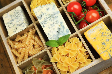 Italian products in wooden box close-up photo