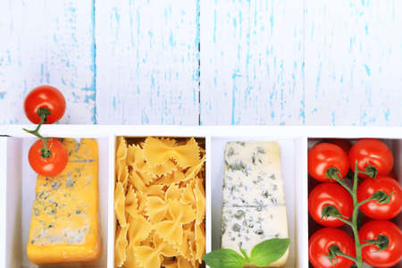 Italian products in wooden box on table close-up photo