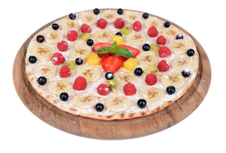 Sweet pizza with fruits isolated on white photo