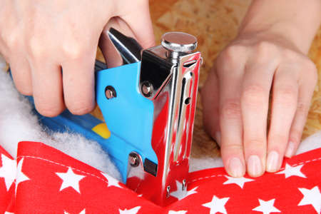 Fastening fabric and board using construction stapler photo