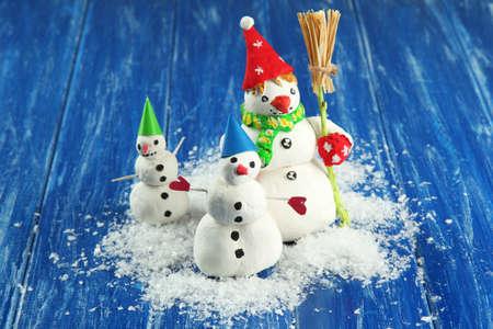 Beautiful snowmen and Christmas decor, on bright background photo
