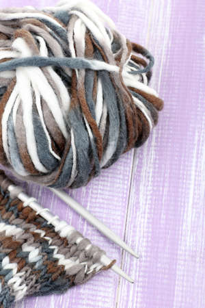 Knitting with spokes on wooden background photo
