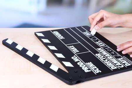 Black cinema clapper board in hands, close up Stock Photo - 29703403