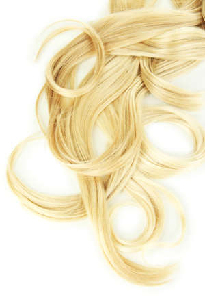 Curly blond hair close-up isolated on white photo
