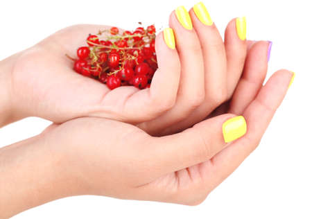 Female hands with stylish colorful nails holding ripe berries, isolated on white photo
