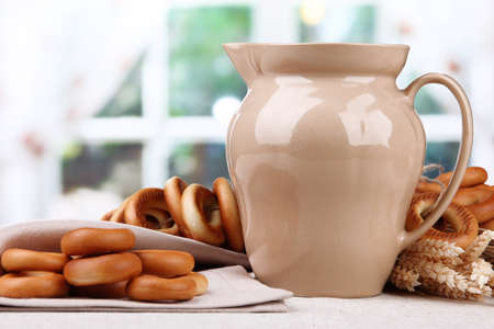 spikelets: jar of milk, tasty bagels and spikelets on table