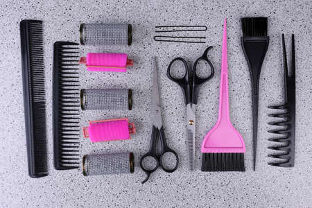 Professional hairdresser tools  on gray background photo