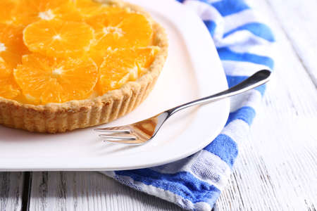 orange tart: Homemade orange tart on plate, on color wooden background Stock Photo