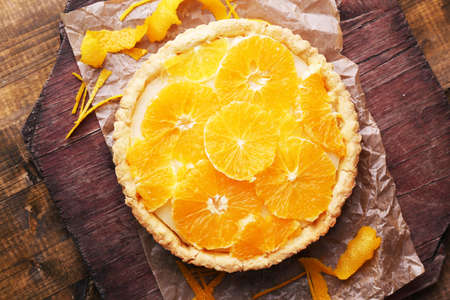 orange tart: Homemade orange tart on wooden background