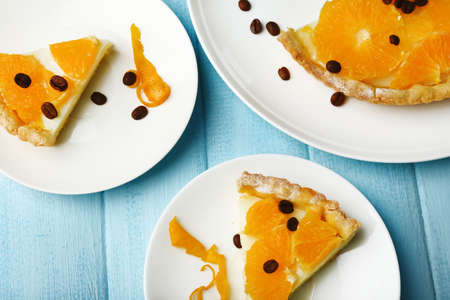 orange tart: Piece of homemade orange tart on plate, on color wooden background Stock Photo